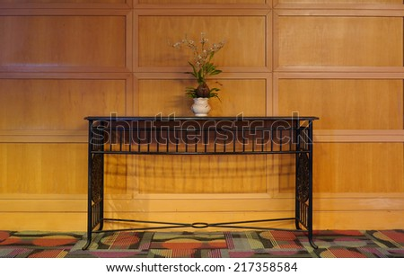 Table  and Flower Vase on wooden wall - stock photo