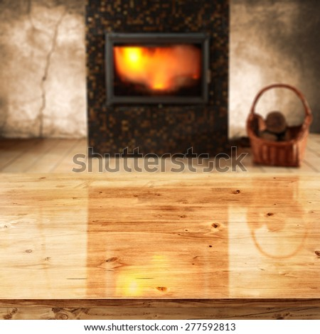 table and interior with fireplace