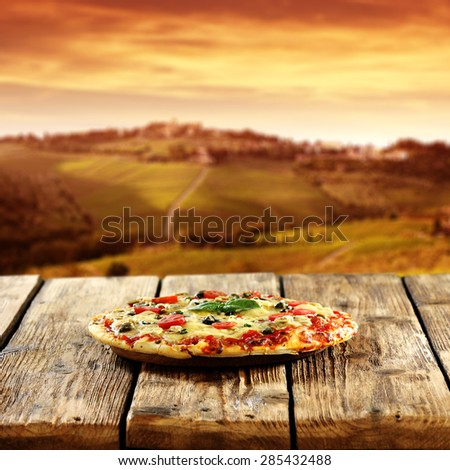 table and pizza  - stock photo