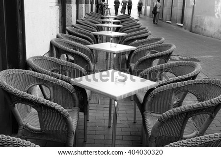 Table and wicker chairs of cafe in Valladolid, Spain - stock photo