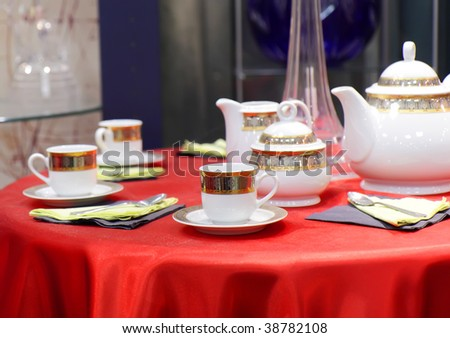 Table appointments on red tablecloth. Focus accent on front. - stock photo