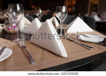 Table arrangement in a restaurant , limited focus depth - stock photo