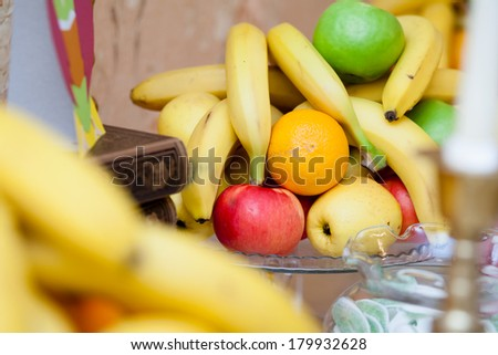 Table arrangement with fruits, books and sweets