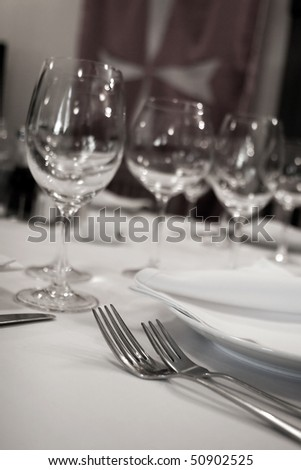 Table at restaurant. Glass and plates - stock photo