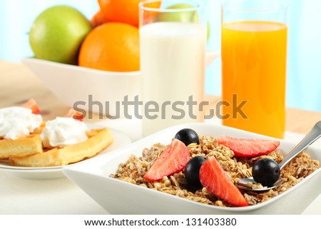 Table Breakfast - Continental Breakfast, fruit, cereals and orange juice - stock photo