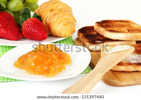 Table Breakfast - Continental Breakfast, fruit, jam, and toast. - stock photo