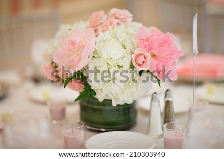 Table centerpiece floral arrangement at luxury event or wedding reception  - stock photo