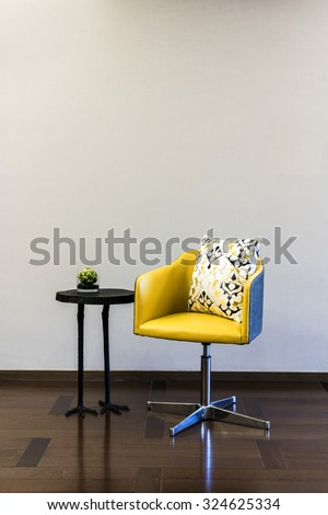 Table Chair combination in front of a plain wall - stock photo