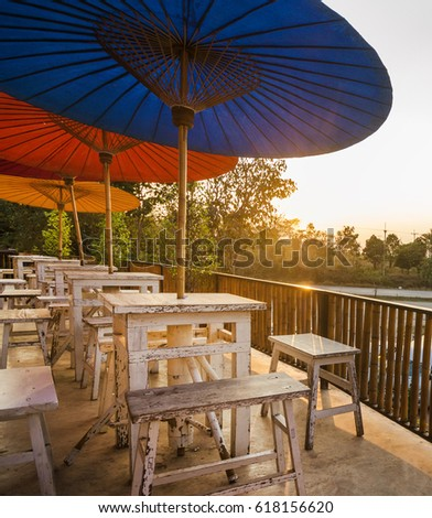 Table,chairs And Umbrella At Terrace Of Cafe,outdoor Corner,retro Cafe