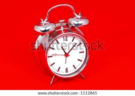 Table clock on red background