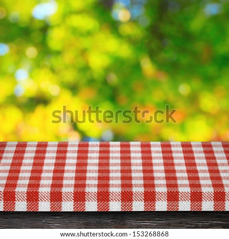 Table cloth and autumn background - stock photo