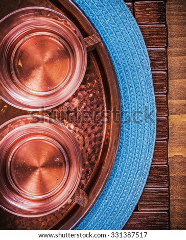 Table cloth coppery tray tea cups food and drink concept.