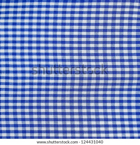 Table cloth in blue checks - stock photo
