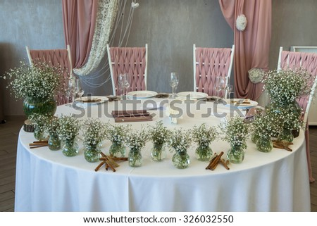Table decor with flowers at wedding. Beautiful flowers on table in wedding day
