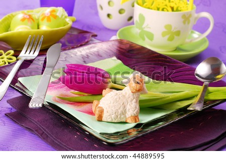 table decorated for easter time in purple and green colors