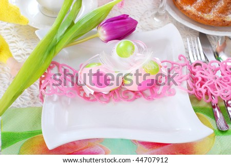 table decorated for easter time in white and pink colors