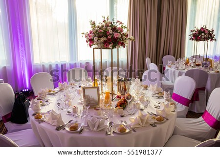 Table decorated with flowers with tableware prepared for a family celebration