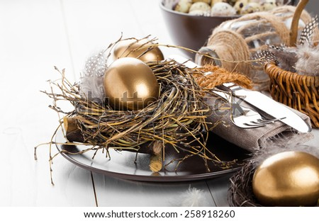 table decoration on white wooden background with Chicken golden egg - stock photo