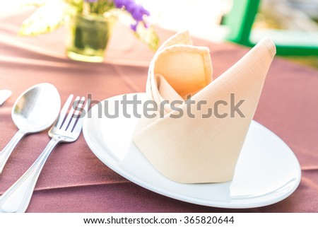 Table dining set in the restaurant - light filter effect processing style pictures - Selective focus point - stock photo