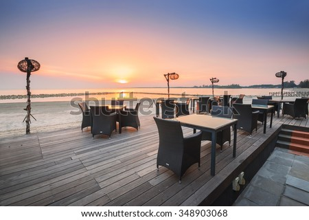 Table dinner setting at the beach on twilight time in Bagan Lalang, Selangor, Malaysia. - stock photo