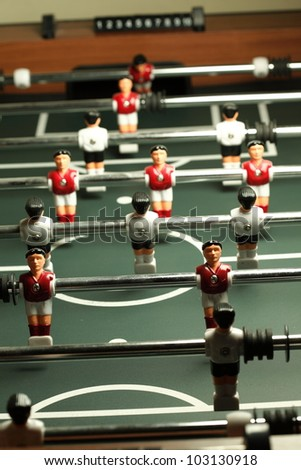 Table football game, Soccer table with red and blue players - stock photo