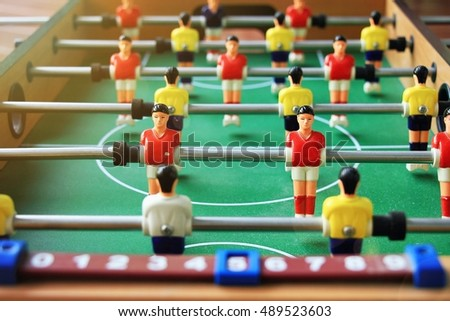 Table football game, Soccer table with red and yellow players. (Lighting Effect Processed)