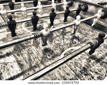 Table football game, Soccer table with yellow and black players. - stock photo