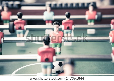 Table football game with red and blue player