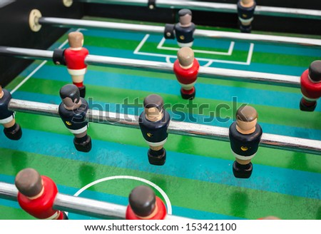 Table football game with red and blue players  - stock photo
