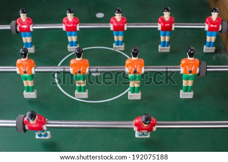 Table football game with red and orange players