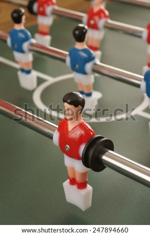 Table football players selective focus on red player - stock photo