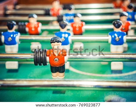 table football soccer game kicker . Cropped image of foosball. table soccer