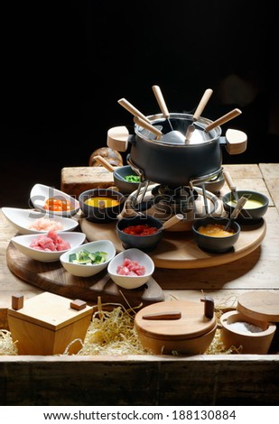 table for a party served with a fondue  - stock photo