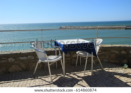 Table for two in a restaurant overlooking the sea