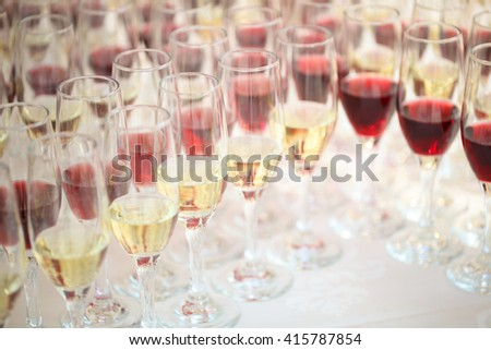 table full with champagne glasses - stock photo