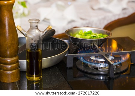 table gas stove frying pan kitchen tools - stock photo