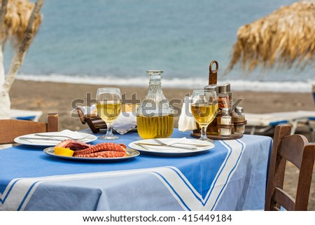 Table in a fish restaurant on the beach for two