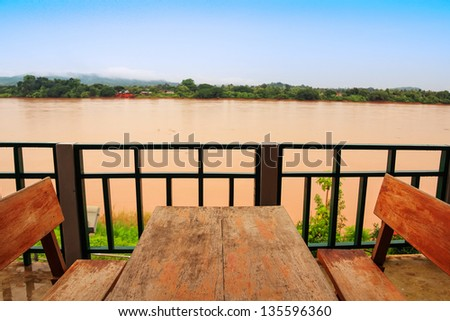 Table in a restaurant on the river