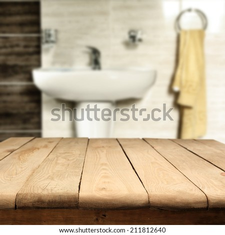 table in bathroom and wall of stone  - stock photo