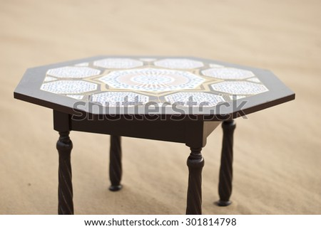 table in desert sahara morocco africa yellow sand