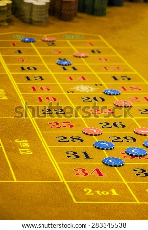 Table in gambling casino, counters - stock photo