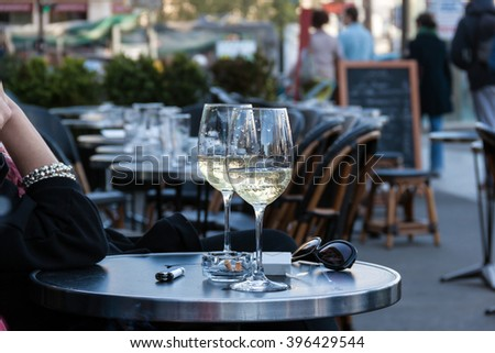 Table in Parisian cafe - stock photo