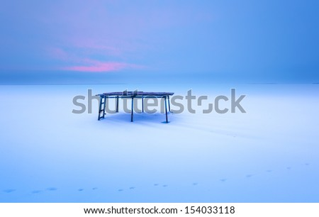 table in the snow - stock photo