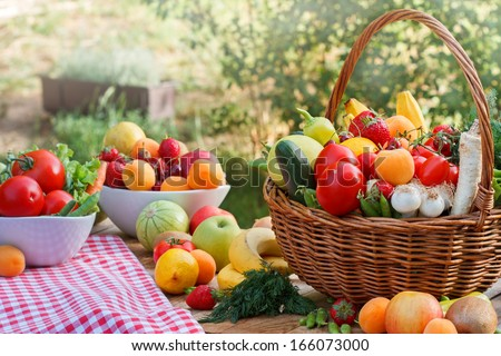 Table is full of various organic fruits and vegetables - stock photo