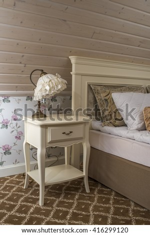 Table lamp in the bedroom - stock photo
