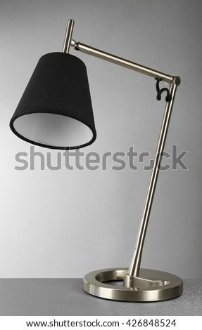 Table lamp on gray background