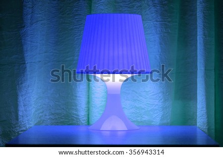 Table lamp with soft light in the bedroom - stock photo
