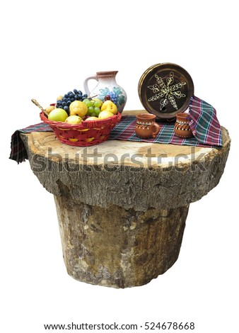 table made of logs with fruit basket and small wine barrel