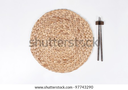 Table Mat with Chopsticks - stock photo