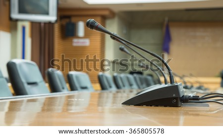 Table microphone at meeting room - stock photo
